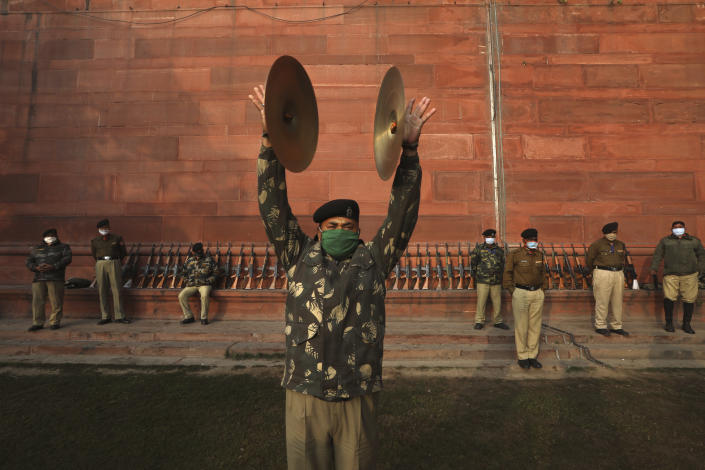 An Indian Border Security Force soldier rehearses during a brass band practice for the upcoming Republic Day parade in New Delhi, India, Thursday, Jan. 21, 2021. Republic Day marks the anniversary of the adoption of the country's constitution on Jan. 26, 1950. Thousands congregate on Rajpath, a ceremonial boulevard in New Delhi, to watch a flamboyant display of the country's military power and cultural diversity. (AP Photo/Manish Swarup)
