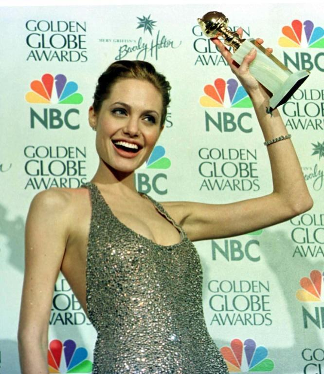 "After Angelina Jolie won a Golden Globe for Best Actress in a TV Movie for her role in ""Gia"" in 1999 (she is seen here with the award), she jumped into the pool at the Beverly Hilton"
