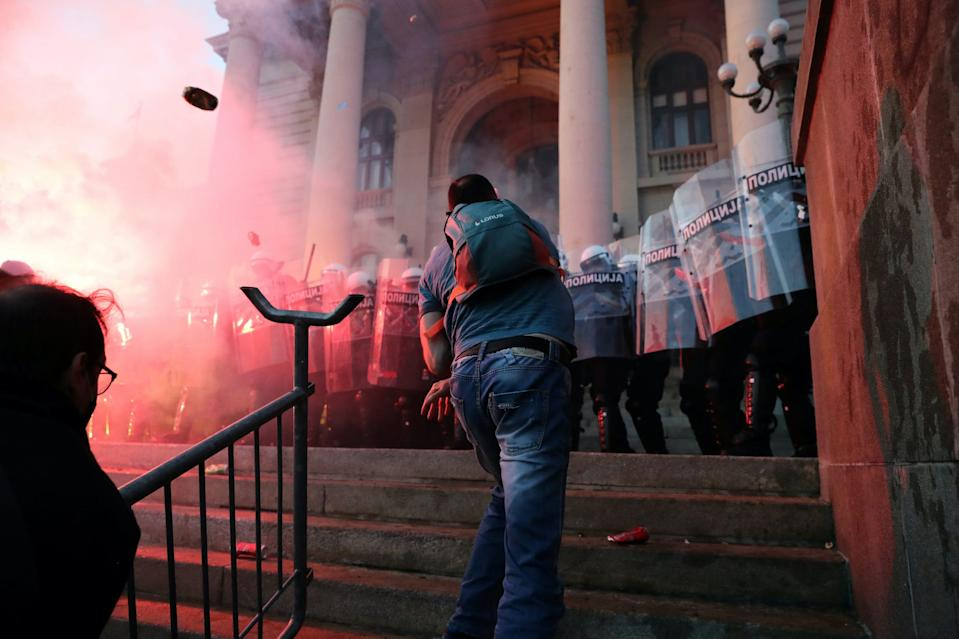 Demonstrators clash with police during an anti-government rally, amid the spread of the coronavirus, in front of the parliament building in Belgrade, Serbia, on July 8, 2020.