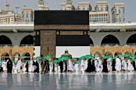 Women clad in black join men dressed in white as they circle the Kaaba, one of the key rituals of the hajj in Mecca, Saudi Arabia's holiest Muslim site