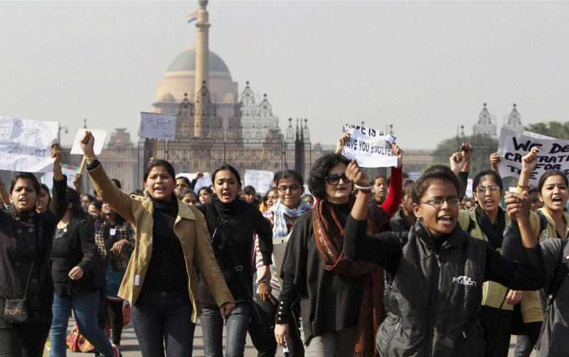 Activist of the All India Democratic Women's Association and Young Women's Christian Association (YWCA) students shout slogans as they take part in a protest march from the Presidential Palace to India Gate in New Delhi, India, Friday, Dec. 21, 2012. The gang-rape and beating of a 23-year-old student by six men on a bus in New Delhi may have sparked days of protests and demands for authorities to take tougher action, but for women in India it is just an extreme example of what they have to live with. (AP Photo)