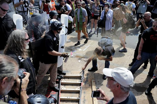 "<p>White nationalists, neo-Nazis and members of the ""alt-right"" clash with counter-protesters as they attempt to guard the entrance to Lee Park during the ""Unite the Right"" rally Aug. 12, 2017 in Charlottesville, Va. (Photo: Chip Somodevilla/Getty Images) </p>"