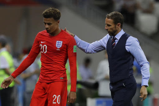 England head coach Gareth Southgate escorts Dele Alli after replacing him with Ruben Loftus-Cheek during the group G match against Tunisia at the 2018 soccer World Cup in the Volgograd Arena in Volgograd, Russia, Monday, June 18, 2018. (AP Photo/Alastair Grant)