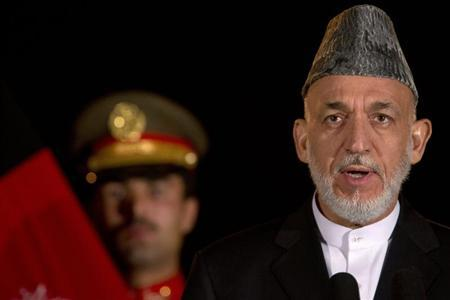 Afghan President Karzai speaks during a news conference with U.S. Secretary of State Kerry in Kabul