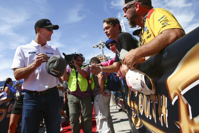 Kevin Harvick gives autographs to fans before a NASCAR Cup Series auto race at Las Vegas Motor Speedway, Sunday, Sept. 15, 2019. (AP Photo/Chase Stevens)