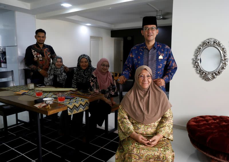 Tengku Shawal poses for photos with his family in Singapore