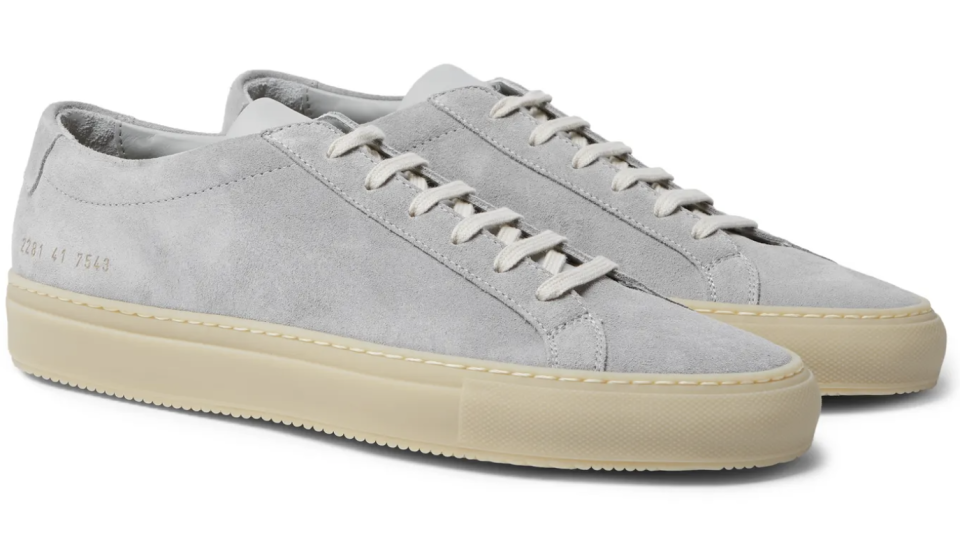 """<p><strong>Common Projects</strong></p><p>mrporter.com</p><p><strong>$425.00</strong></p><p><a href=""""https://go.redirectingat.com?id=74968X1596630&url=https%3A%2F%2Fwww.mrporter.com%2Fen-us%2Fmens%2Fproduct%2Fcommon-projects%2Fshoes%2Flow-top-sneakers%2Fachilles-suede-sneakers%2F8008779905900078&sref=https%3A%2F%2Fwww.esquire.com%2Fstyle%2Fmens-fashion%2Fg35083025%2Fmr-porter-end-of-season-sale-2020%2F"""" rel=""""nofollow noopener"""" target=""""_blank"""" data-ylk=""""slk:Shop Now"""" class=""""link rapid-noclick-resp"""">Shop Now</a></p>"""