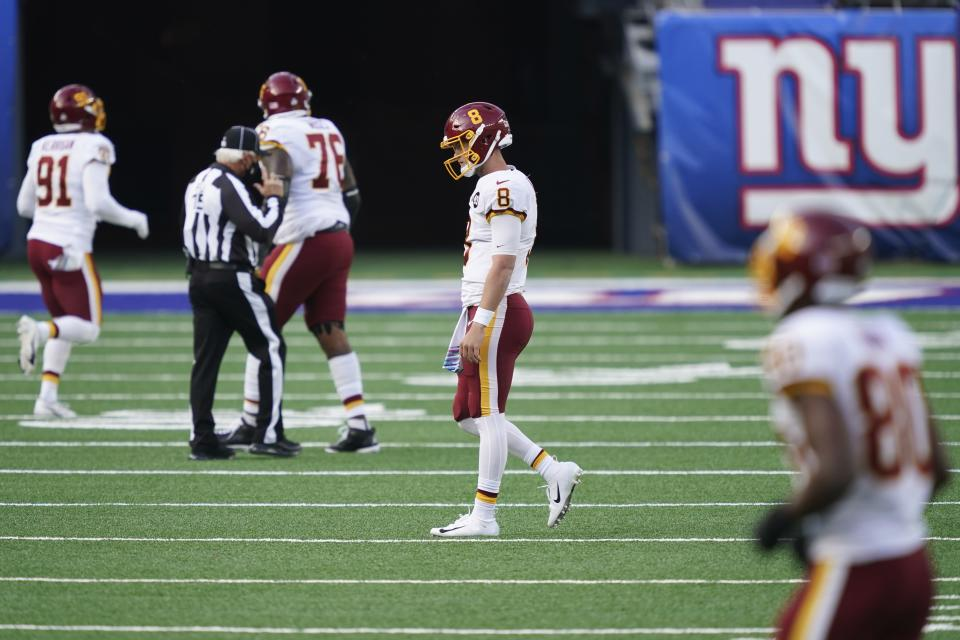 Washington Football Team quarterback Kyle Allen (8) reacts after fumbling the ball during the second half of an NFL football game against the New York Giants, Sunday, Oct. 18, 2020, in East Rutherford, N.J. The ball was recovered by the Giants and returned for a touchdown on the play. (AP Photo/John Minchillo)