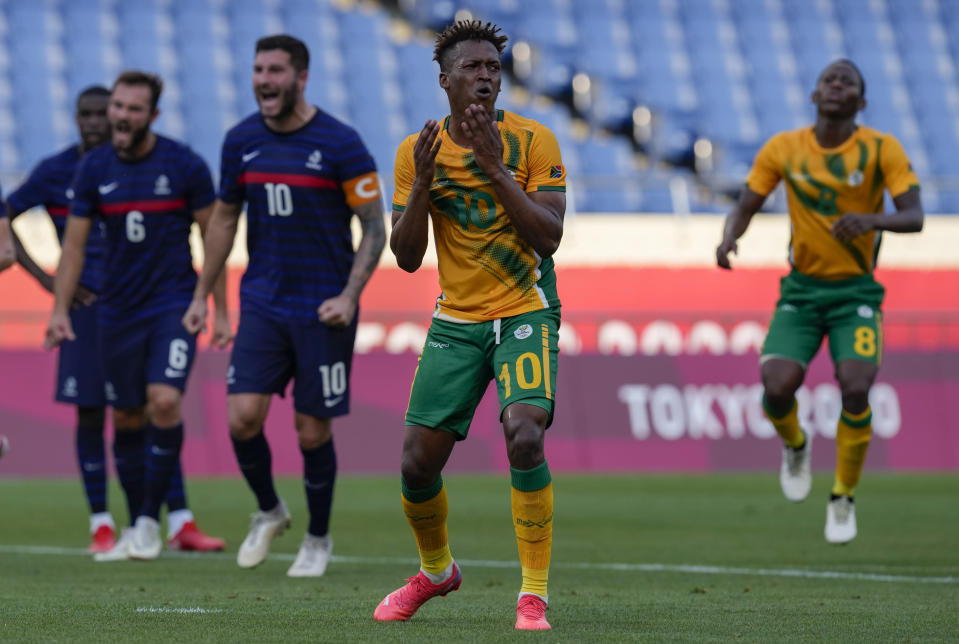 Luther Singh of South Africa, center, reacts after missing a penalty kick during a men's soccer match against France at the 2020 Summer Olympics, Sunday, July 25, 2021, in Saitama, Japan. (AP Photo/Martin Mejia)