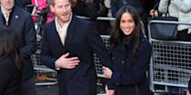 <p>In their first official public engagement since announcing their plans to marry, Meghan made a <em>pretty </em>bold statement about who the subject of her affections was, with a hand-hold and an arm cling. To be fair, it was probably subconscious reassurance she was seeking from her husband-to-be, given the large, excitable crowds who came out to see them.</p>