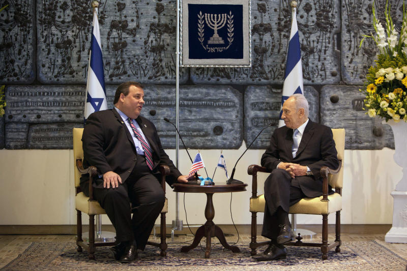 New Jersey Gov. Chris Christie, left, speaks with Israeli President Shimon Peres during their meeting at the President's residence in Jerusalem, Tuesday, April. 3, 2012. Christie kicked off his first official overseas trip Monday meeting Israel's leader in a visit that may boost the rising Republican star's foreign policy credentials ahead of November's presidential election.(AP Photo/Oded Balilty)