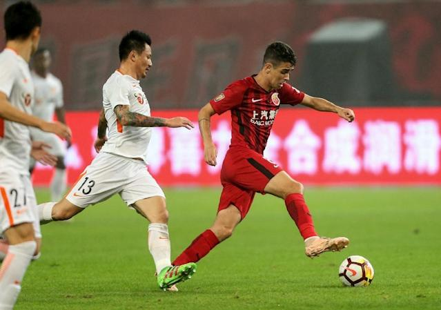 SIPG has the expensive Brazilian duo of Oscar and Hulk, and wrapped up the title with a game to spare (AFP Photo/STR)