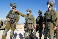 Israeli soldiers monitor the country's border with Lebanon near the northern town of Metula on July 14