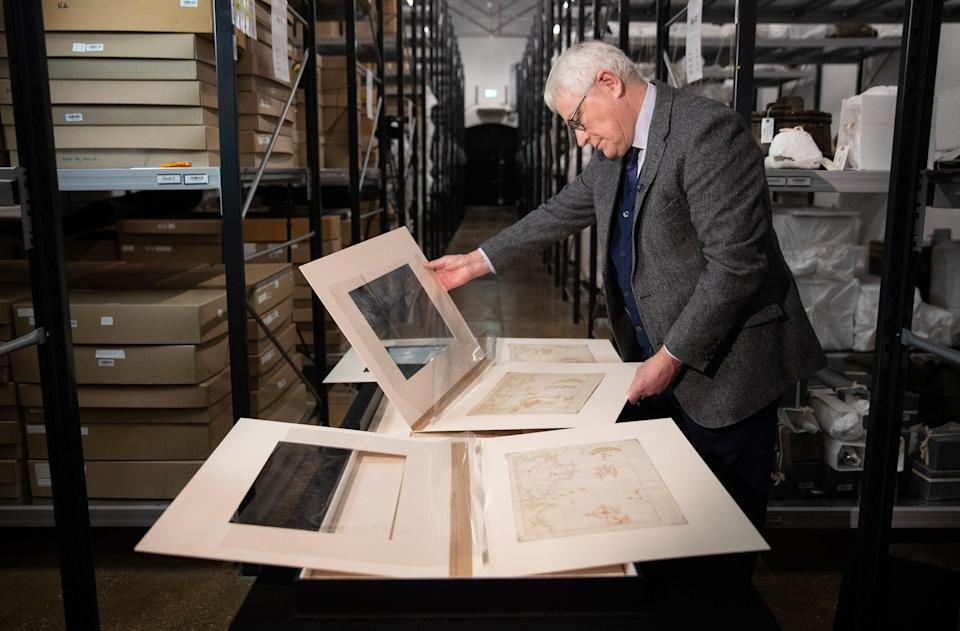 <p>Professor Dominic Tweddle, Director General of the National Museum of the Royal Navy, looks at one of the 'Armada Maps' at Portsmouth Historic Dockyard</p> (PA)