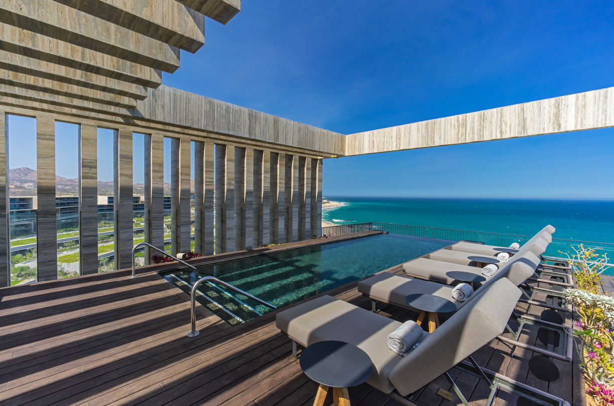 """<p>Located in between Cabo San Lucas and San José del Cabo, <a href=""""https://www.marriott.com/hotels/travel/sjdlc-solaz-a-luxury-collection-resort-los-cabos/"""" target=""""_blank"""">Solaz, a Luxury Collection Resort</a> not only offers guests beachfront access (facing the Sea of Cortez), but also a beautifully modern property that has won countless awards. Holding a good mix of both modern and native aesthetics, this resort is perfect for any couples looking to zone out from the hustle and bustle other properties Cabo San Lucas can bring. For a cool $29,969.00, the residences experience <a href=""""https://www.marriott.com/hotels/hotel-deals/sjdlc-solaz-a-luxury-collection-resort-los-cabos/"""" target=""""_blank"""">package</a> provides: luxury transportation to and a from the airport, a penthouse residence with a private rooftop, algae based wrap massages, a dedicated onsite artisan butler, an Omakase dinner at the onsite restaurant <a href=""""https://edokobayashi.com/index.php/misaki/"""" target=""""_blank"""">Misaki</a>, an in-room dinner prepared by an onsite chef and wait staff, a private tour of <a href=""""https://todossantos.cc"""" target=""""_blank"""">Todo Santos</a>, a beautiful artisan town with numerous art galleries and more! If the price doesn't match your budget, each of these offers are available to purchase separately. </p>"""
