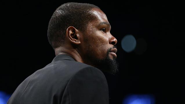 Kevin Durant is among four Brooklyn Nets players who tested positive for coronavirus. (Mike Stobe/Getty Images)