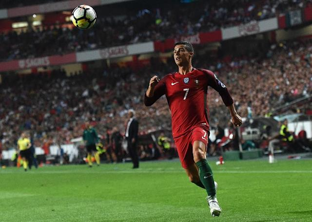 Portugal's midfielder Cristiano Ronaldo eyes the ball during the FIFA World Cup 2018 Group B qualifier football match against Switzerland at the Luz Stadium in Lisbon on October 10, 2017 (AFP Photo/FRANCISCO LEONG)