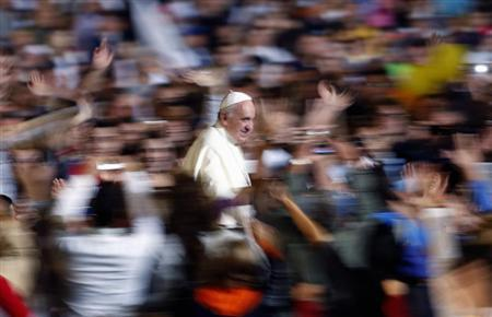 Pope Francis leaves at the end of his special audience with families at St. Peter Square in Vatican