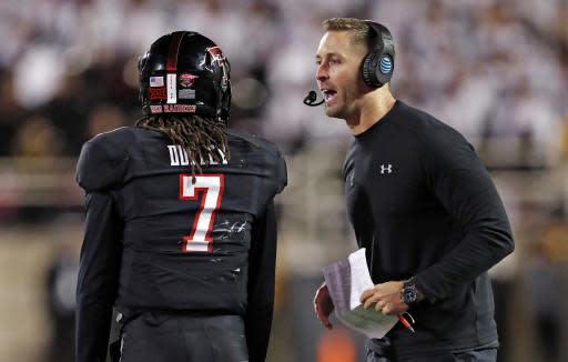 FILE - In this Saturday, Nov. 3, 2018, file photo, Texas Tech coach Kliff Kingsbury talks to quarterback Jett Duffey (7) during a timeout in the second half of an NCAA college football game against Oklahoma in Lubbock, Texas. Duffey is expected to get his second start on Saturday against Texas. (AP Photo/Brad Tollefson, File)