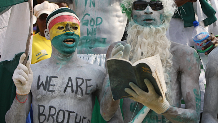 A Ghanaian and Nigerian football fans at the Africa Cup of Nations quarter final match between Ghana and Nigeria in Accra, Ghana - February 2008