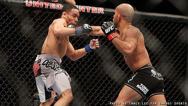 Demetrious Johnson and John Dodson trade punches. (Credit: Tracy Lee for Y! Sports)