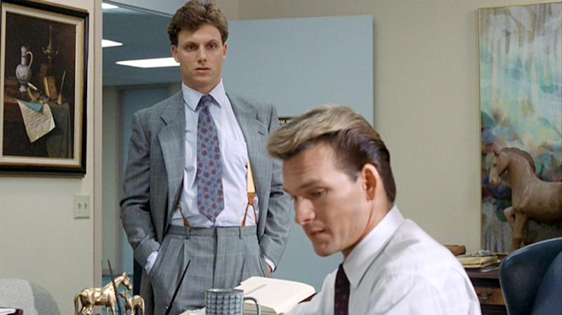 "LOS ANGELES - JULY 13: The movie ""Ghost"", directed by Jerry Zucker and written by Bruce Joel Rubin. Seen here, from left, Tony Goldwyn as Carl Bruner observes Patrick Swayze as Sam Wheat working at Market Security Bank & Trust. Initial theatrical release July 13, 1990. Screen capture. Paramount Pictures. (Photo by CBS via Getty Images)"