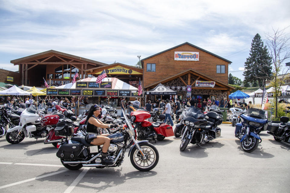 A biker rides down Main Street during the 80th annual Sturgis Motorcycle Rally on Saturday, Aug. 15, 2020, in Sturgis, S.D. (Amy Harris/Invision/AP)