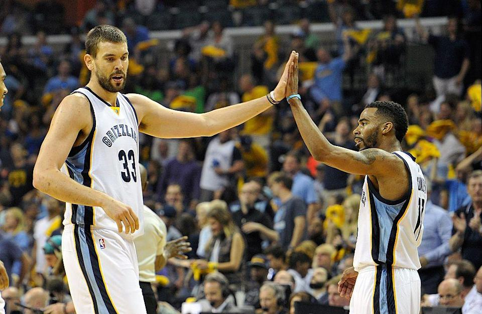 Marc Gasol high fives teammate Mike Conley during Game 1 of the 2015 Western Conference quarterfinals against the Portland Trail Blazers. (Frederick Breedon/Getty Images)