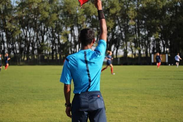 The Alberta Soccer Association would typically register around 2,400 referees, according to its executive director. (Submitted by Alberta Soccer Association - image credit)
