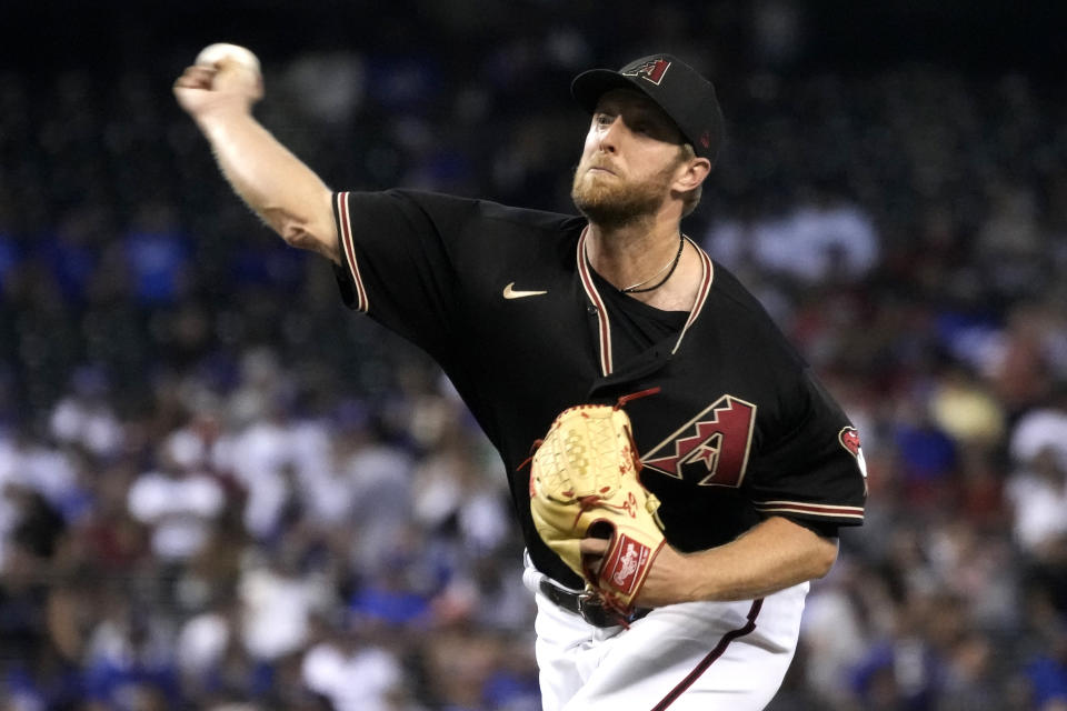 Arizona Diamondbacks pitcher Merrill Kelly throws to a Los Angeles Dodgers batter during the first inning of a baseball game Saturday, July 31, 2021, in Phoenix. (AP Photo/Rick Scuteri)