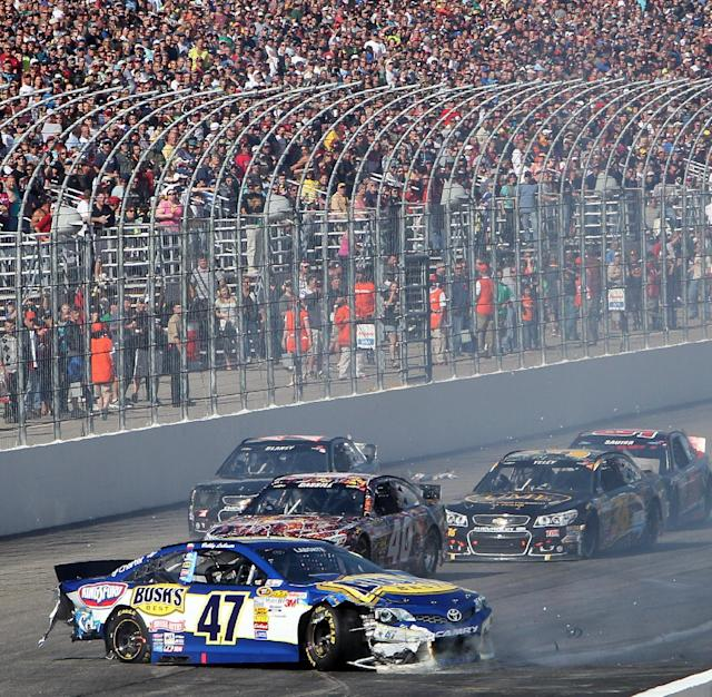 NASCAR driver Bobby Labonte (47) spins on the front straightaway during the NASCAR Sprint Cup Series auto race at New Hampshire Motor Speedway, Sunday, Sept. 22, 2013, in Loudon, N.H. (AP Photo/Jim Cole)