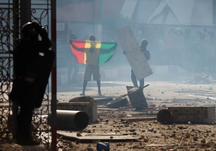 FILE PHOTO: Supporters of opposition leader Ousmane Sonko clash with security forces, in Dakar