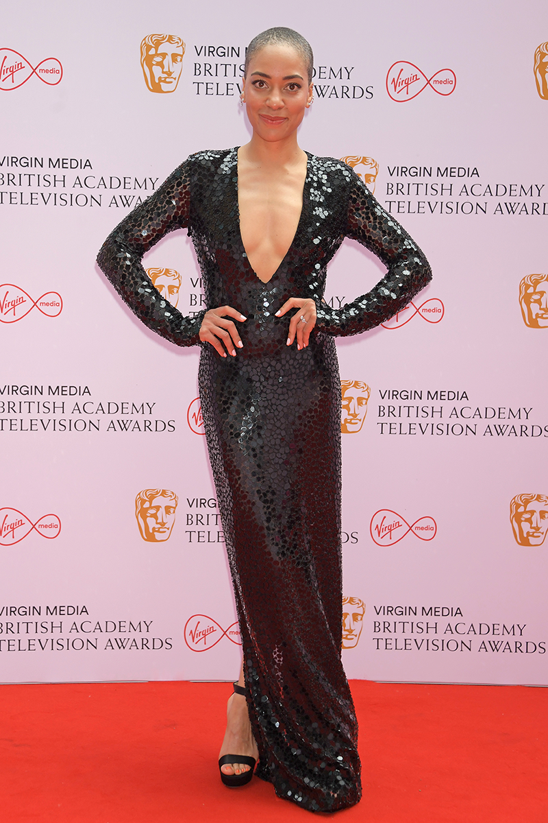 <p>Cush Jumbo goes for a plunging neckline in this sequin LBD (that's little black dress, for those playing at home).</p>