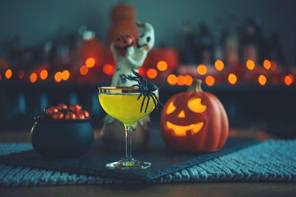 """<p>Want to liven up a regular old Halloween cocktail party? Stir up some friendly competition by having party goers come prepared to whip up a <a href=""""https://www.oprahmag.com/life/food/g28099287/fall-cocktails/"""" rel=""""nofollow noopener"""" target=""""_blank"""" data-ylk=""""slk:fall cocktail"""" class=""""link rapid-noclick-resp"""">fall cocktail</a> on the spot. You provide the basics—booze, glassware, garnishes—and ask each guest to bring one special ingredient of choice. Get to sippin'! <br></p>"""