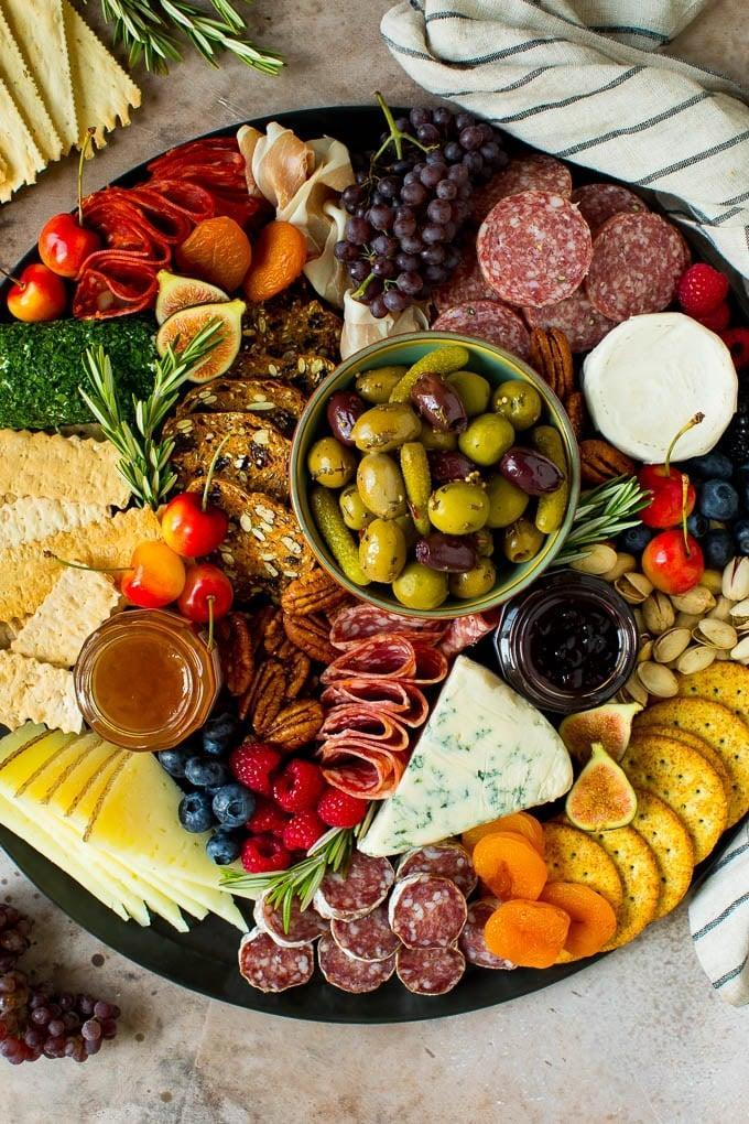 "<p><a href=""https://www.popsugar.com/latest/Charcuterie"" class=""link rapid-noclick-resp"" rel=""nofollow noopener"" target=""_blank"" data-ylk=""slk:Charcuterie boards"">Charcuterie boards</a> are jam-packed with mouthwatering cheeses, crunchy crackers, hearty meats, and fresh fruits, and figuring out how much of that stuff you need to feed two people is always a struggle. Luckily, this recipe is easy to tweak, meaning you can make the perfect amount for you and your cheese-loving friends in no time.</p> <p><strong>Get the recipe:</strong> <a href=""https://www.dinneratthezoo.com/charcuterie-board/#wprm-recipe-container-29040"" class=""link rapid-noclick-resp"" rel=""nofollow noopener"" target=""_blank"" data-ylk=""slk:charcuterie board"">charcuterie board</a></p>"