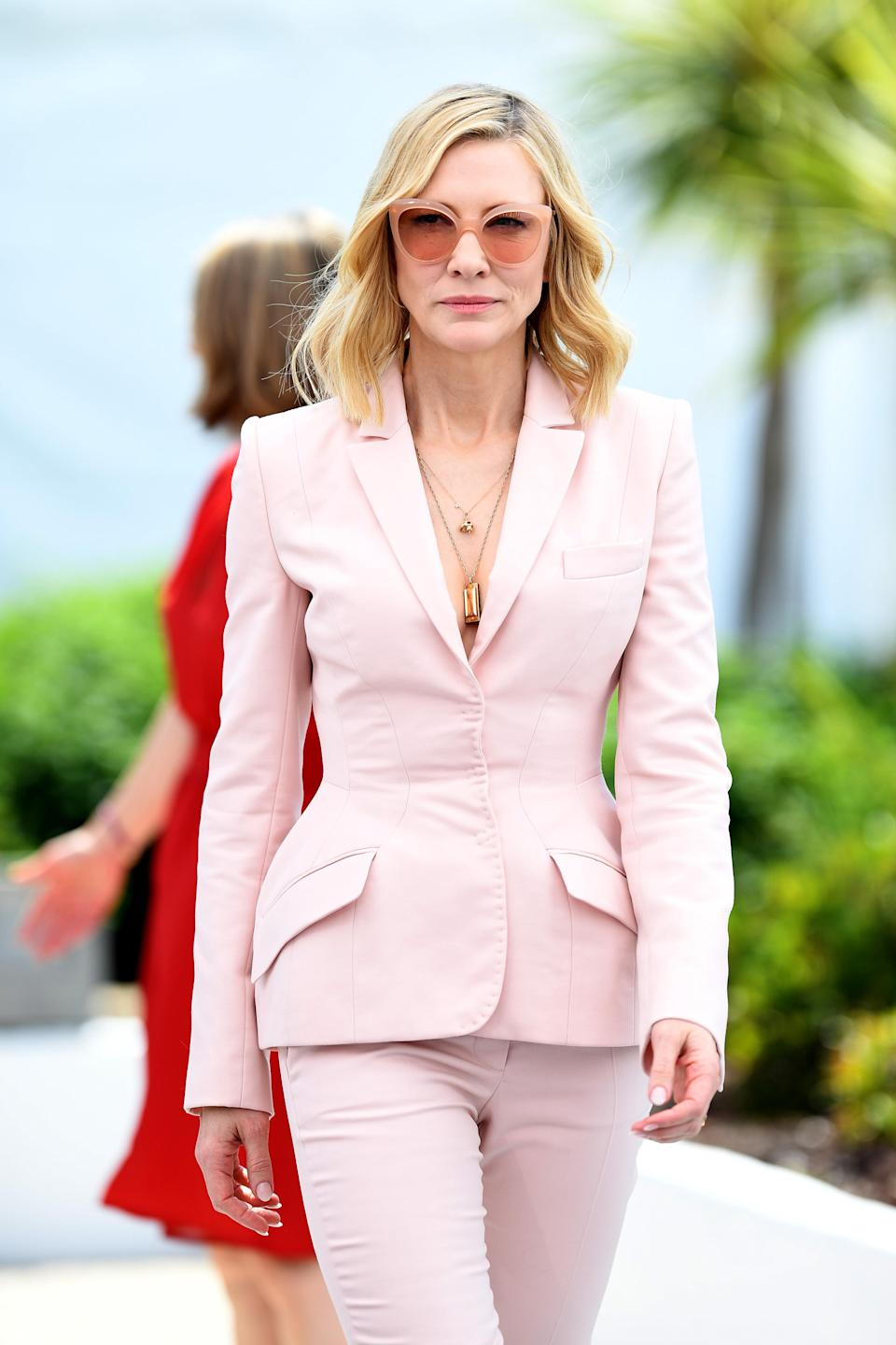 <p>The Ocean's Eight star looked pretty yet powerful in a blush pink trouser suit at a Cannes photo call. </p>