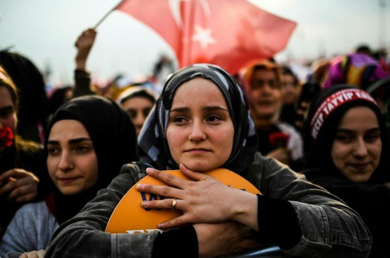 "A woman looks on during a rally for the ""yes"" campaign in Istanbul, on April 8, 2017"