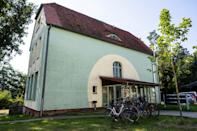 The house in which Merkel's family lived in Templin is on the edge of a wood, with a home for the disabled that they ran next door (AFP/John MACDOUGALL)
