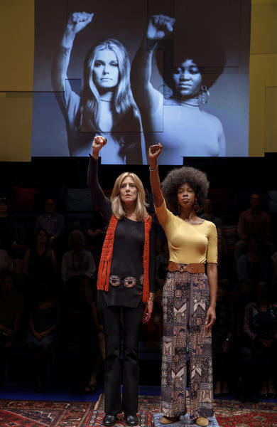 """In this image released by PBS, Christine Lahti, portrays Gloria Steinem, left, and Fedna Jacquet portrays Dorothy Pitman Hughes in a scene from """"Gloria - A Life."""" The taped theater production airs Friday on PBS. (Joan Marcus/PBS via AP)"""