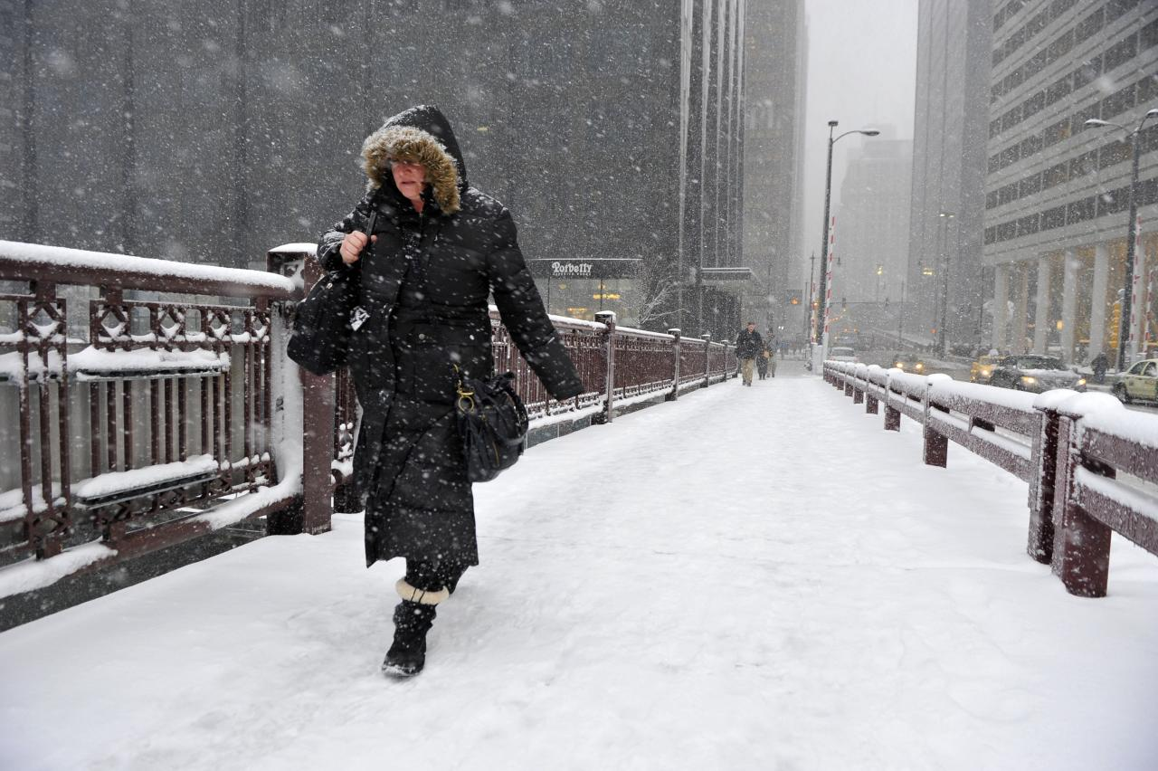 CHICAGO, IL - MARCH 5:  Jennifer Mosby crosses the Adams Street bridge over the Chicago River on March 5, 2013 in Chicago, Illinois. The worst winter storm of the season is expected to dump 7-10 inches of snow on the Chicago area with the worst expected for the evening commute.  (Photo by Brian Kersey/Getty Images)