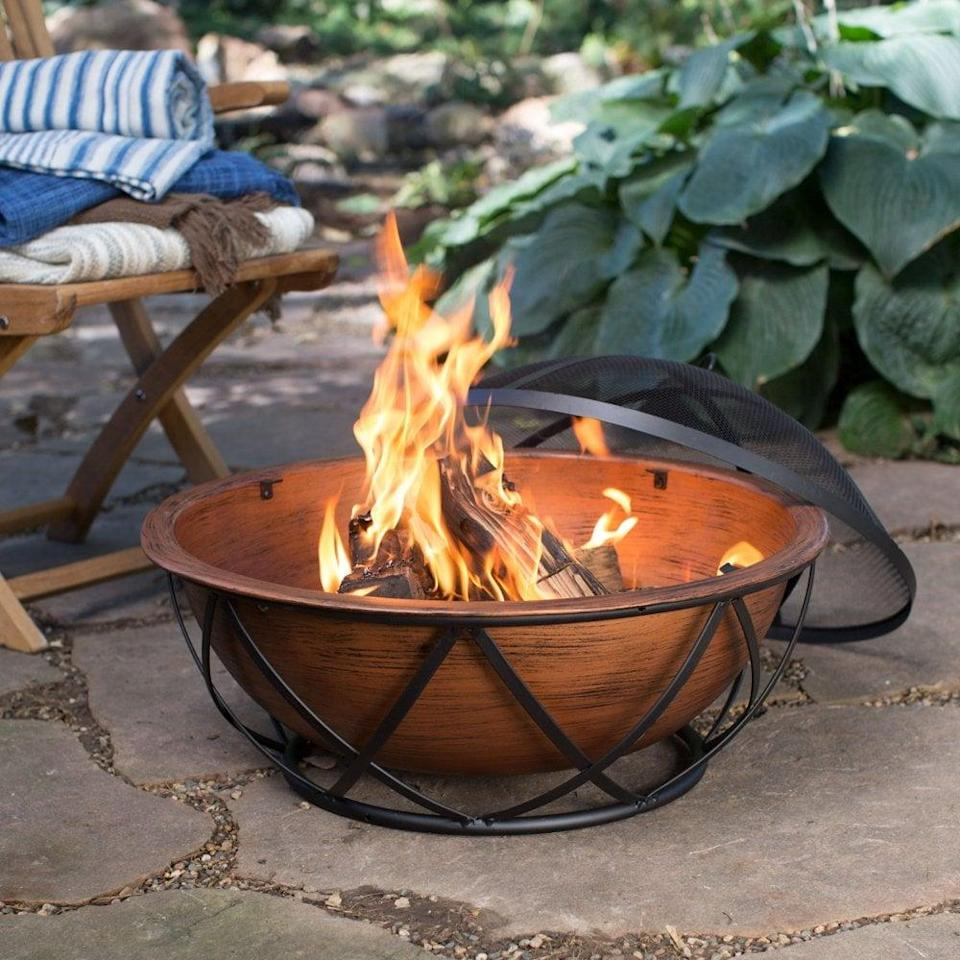 <p>The decorative base on this <span>Coral Coast Taos Rubbed Bronze Wood Burning Fire Pit</span> ($130, originally $200) will make it an eye-catching outdoor piece.</p>
