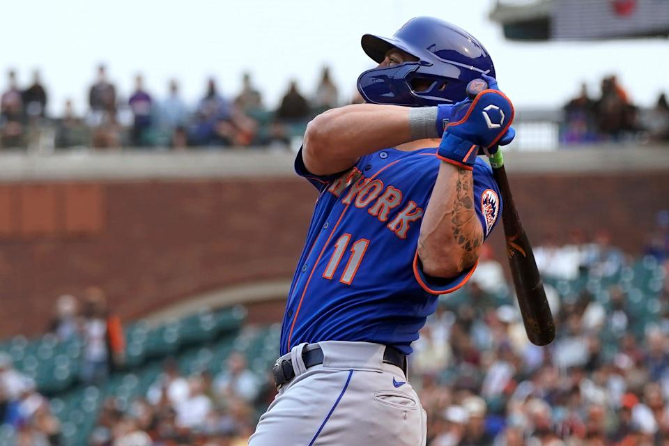 New York Mets' Kevin Pillar watches his three-run home run against the San Francisco Giants during the 12th inning of a baseball game in San Francisco, Wednesday, Aug. 18, 2021. (AP Photo/Jeff Chiu)
