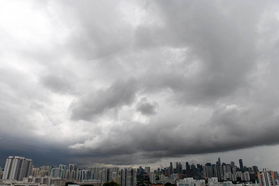 Rain clouds are pictured over the city skyline in Singapore on June 17, 2020. (Photo by ROSLAN RAHMAN / AFP) (Photo by ROSLAN RAHMAN/AFP via Getty Images)