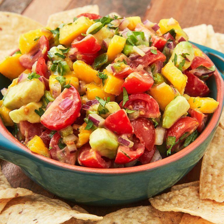 """<p>This salsa has the perfect balance of sweet, spicy, and salty. Served with tortilla chips it makes for a ridiculously addictive snack.</p><p>Get the <a href=""""http://www.delish.com/uk/cooking/recipes/a36461057/mango-salsa-recipe/"""" rel=""""nofollow noopener"""" target=""""_blank"""" data-ylk=""""slk:Mango Salsa"""" class=""""link rapid-noclick-resp"""">Mango Salsa</a> recipe.</p>"""