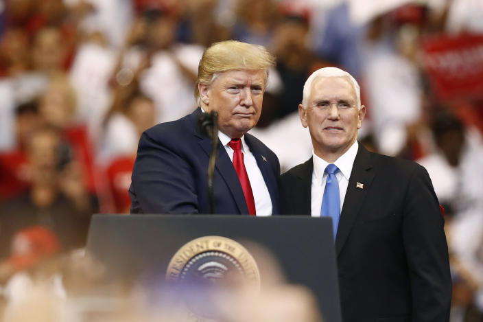 President Donald Trump and Vice President Mike Pence stand together during a campaign rally on Tuesday, Nov. 26, 2019, in Sunrise, Fla. (AP Photo/Brynn Anderson)