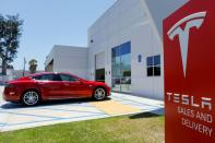 FILE PHOTO: A Tesla sales and service center is shown in Costa Mesa, California