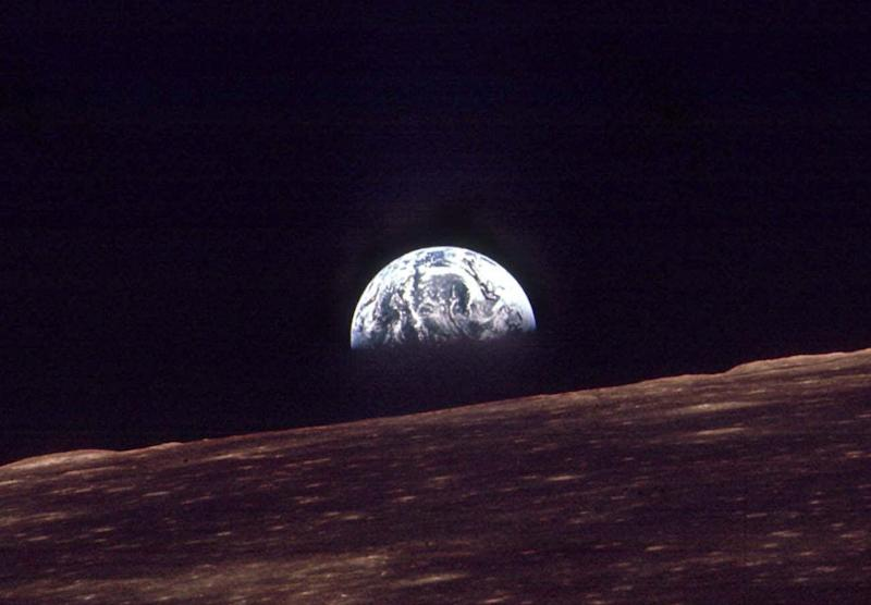 FILE - In this Dec. 24, 1968 file photo, the Earth shines over the horizon of the Moon in as seen by the astronauts on Apollo 8. Apollo 8 was launched from Cape Canaveral on Dec. 21, 1968. (AP Photo/FILE)