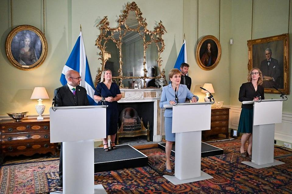 First Minister Nicola Sturgeon (centre) and Scottish Green Party co-leaders Patrick Harvie and Lorna Slater reveal the coalition deal (Jeff J Mitchell/PA) (PA Wire)