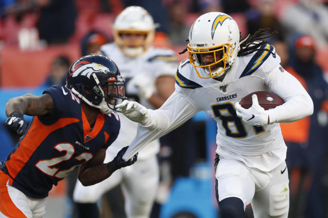 Los Angeles Chargers wide receiver Mike Williams, right, is tackled by Denver Broncos strong safety Kareem Jackson during the first half of an NFL football game Sunday, Dec. 1, 2019, in Denver. (AP Photo/David Zalubowski)