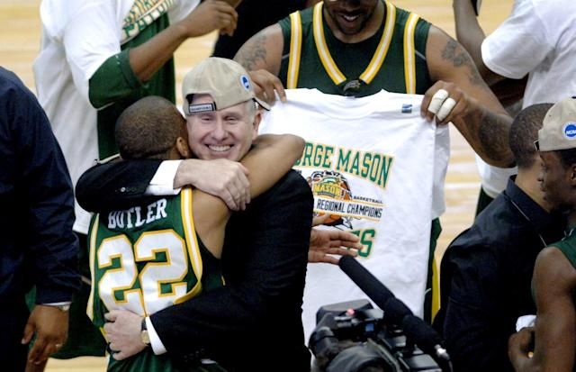 George Mason head coach Jim Larranaga hugs Lamar Butler after the Patriots defeated Connecticut 86-84 during the NCAA regional final at the Verizon Center in Washington, D.C. on March 26, 2006. (Photo by Steve Deslich/MCT/Tribune News Service via Getty Images)